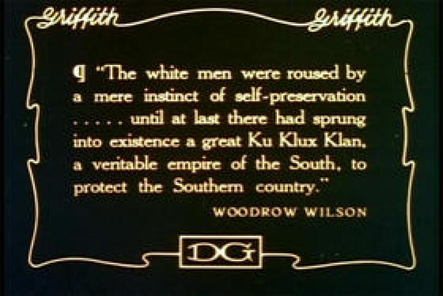 """A caption quoting Woodrow Wilson in the film """"The Birth of a Nation."""""""