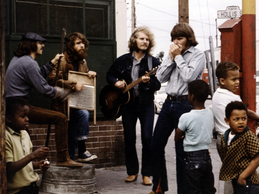 The members of Creedence Clearwater Revival during a street performance and photo shoot in Oakland, Calif. for the band's <em>Willy and the Poor Boys </em>album, also released in 1969.
