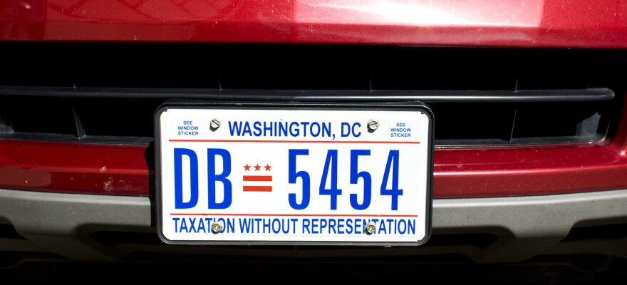 """D.C. residents show their support for statehood with a license plate that reads, """"Taxation Without Representation."""""""
