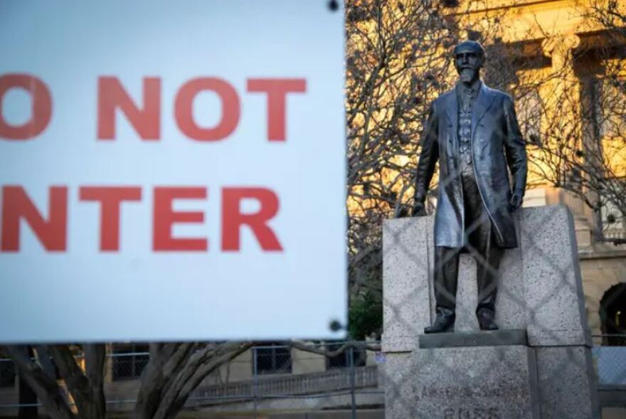 """The statue of former Texas A&M President Lawrence Sullivan """"Sul"""" Ross is fenced off from the rest of campus. The university put up the fence after calls to remove it."""