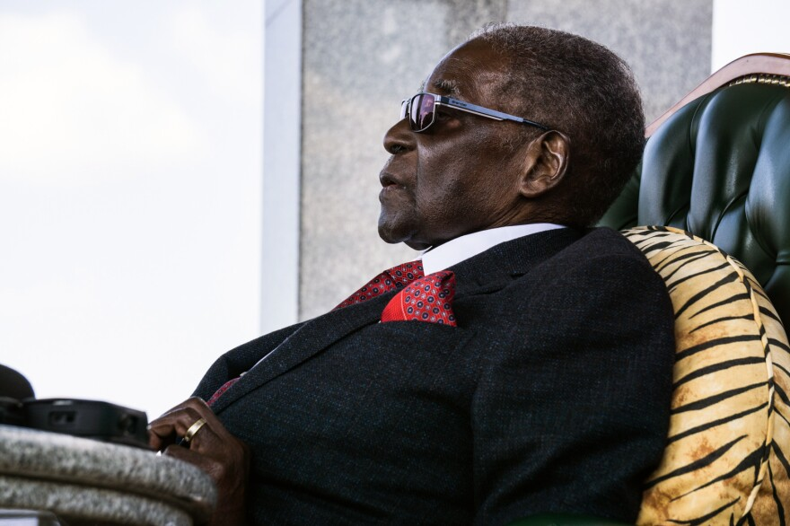 On the eve of Zimbabwe's first election without him on the ballot, former President Robert Mugabe addresses the press at his home.