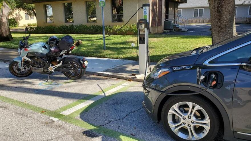 A Zero Motorcycles SR/F and Chevrolet Bolt are pictured charging in St. Augustine.