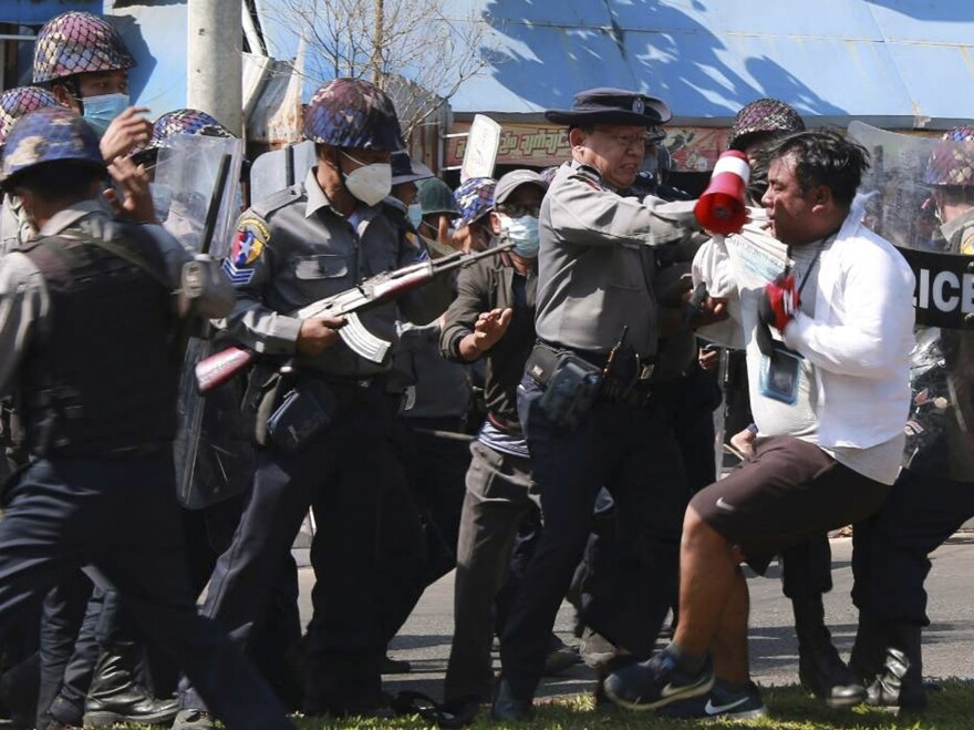 Police arrest a protester during a demonstration against the military coup in Mawlamyine, in Myanmar's Mon State, on Friday.