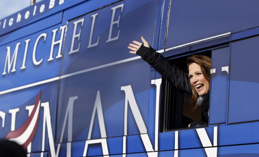 Republican presidential candidate Michele Bachmann waves from her bus after a campaign stop at Valley High School on Tuesday in West Des Moines, Iowa.