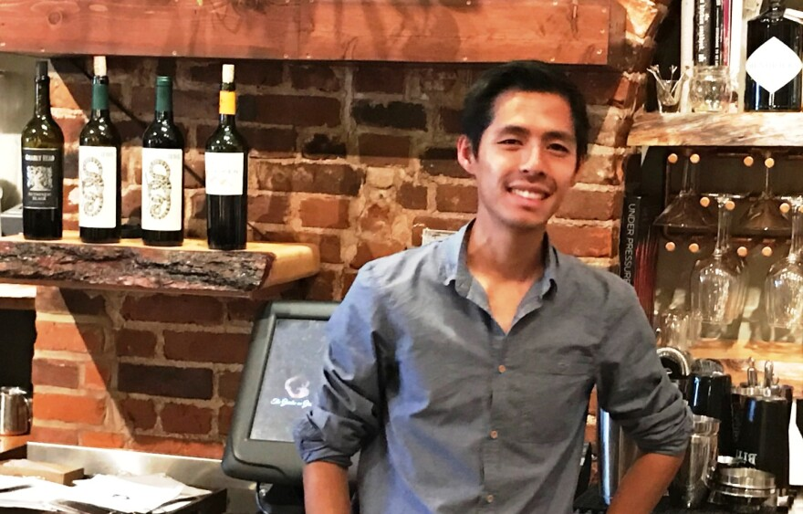 In this November 1, 2016 photo, you can see Cevin Lee posing behind the bar of his Garden on Grand restaurant.