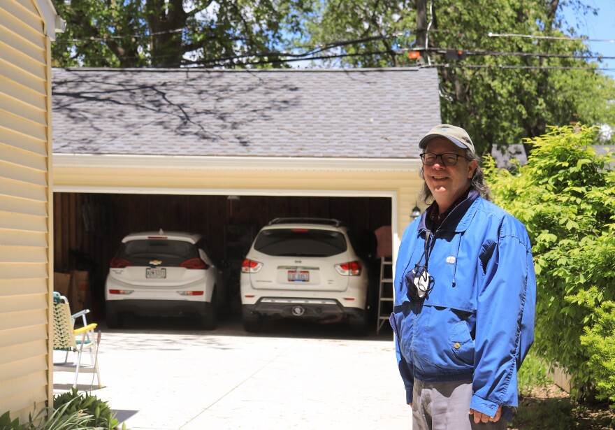Kevin O'Neil standing outside his home.