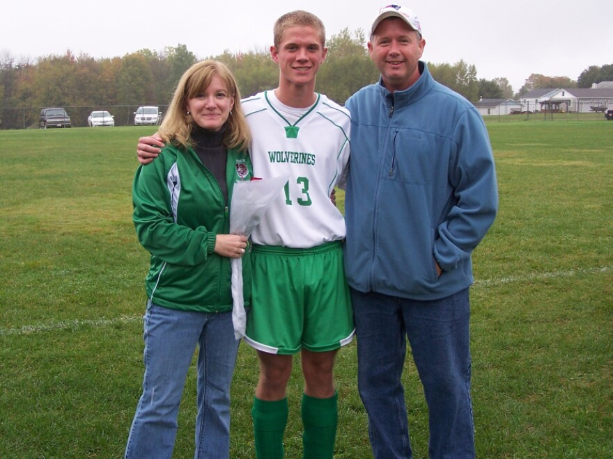"""High school senior Jared Lyons (center), shown here with his parents, Kim and Bob, worries how he'll afford to achieve his dream of becoming a doctor. The economy, he says, """"can't get any worse than it is now."""""""