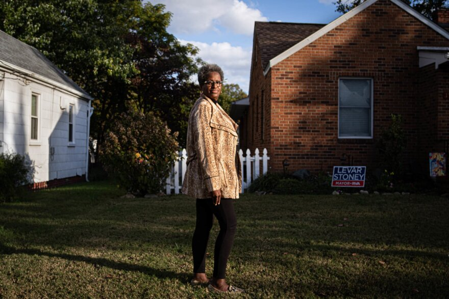 Torey Edmonds stands outside of her red brick home in Richmond, Virginia.