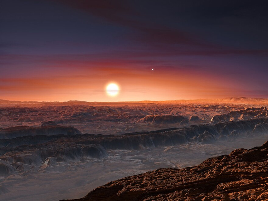 An artist imagines what the surface of the planet Proxima b, orbiting the red dwarf star Proxima Centauri, might look like.