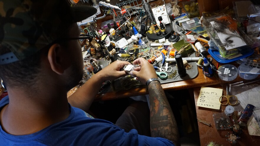 The cluttered desk in Kyle Chanitz's fly-tying studio at his home in Roanoke, Virginia.