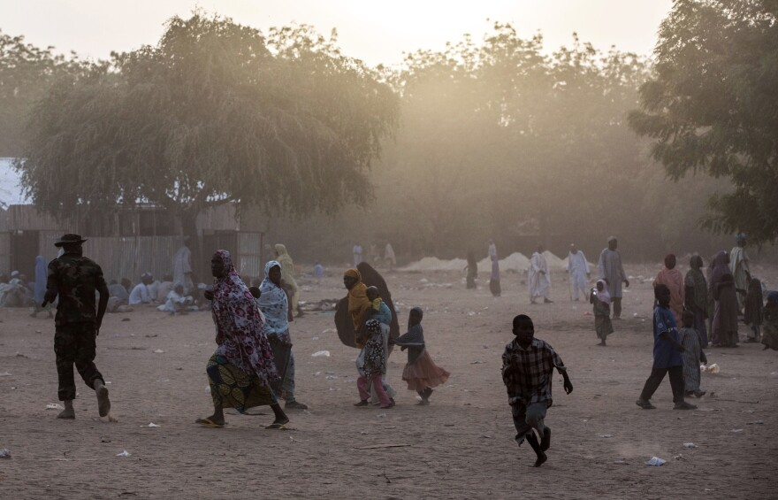 Thousands of civilians have fled recent fighting in Bama, northeast Nigeria, between the Nigerian military and Boko Haram extremists. Election officials are struggling to make sure to get to displaced people such as these at a makeshift camp on the outskirts of Maiduguri, the birthplace of Boko Haram in the northeast.