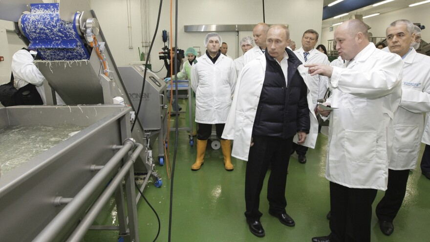 Yevgeny Prigozhin (second right) shows Russian President Vladimir Putin, center, around his Concord Catering factory, outside St. Petersburg in 2010. The company has secured large government contracts to provide school lunches and feed the Russian military.