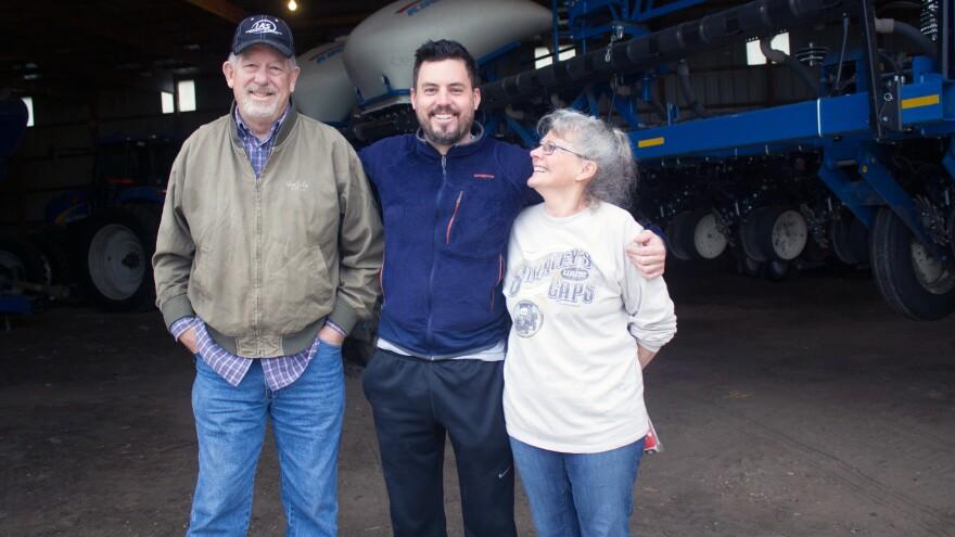 Bob, Robbie and Leah Maass (from left) ready equipment for planting season on their farm near Ellsworth, Iowa.