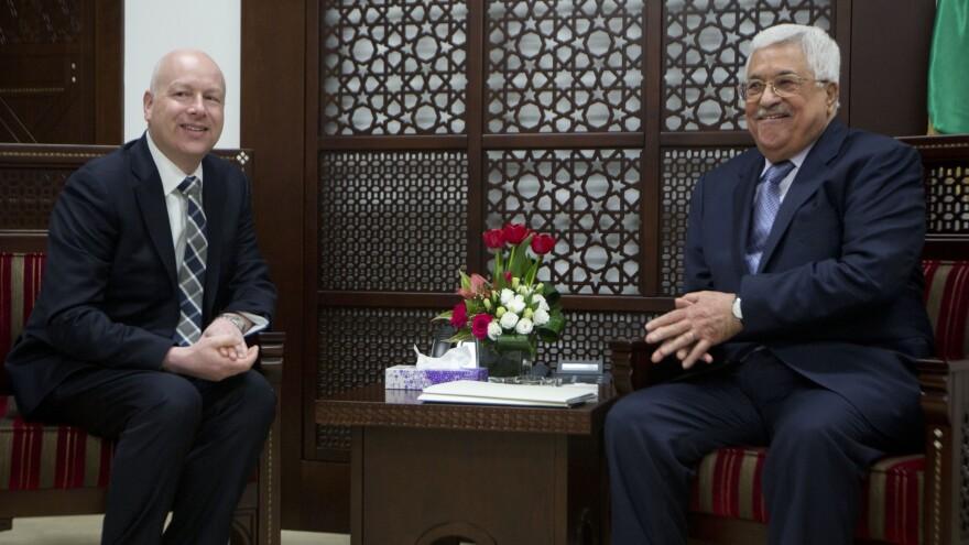 President Trump's peace envoy Jason Greenblatt (left) meets with Palestinian President Mahmoud Abbas in Ramallah in the West Bank on Tuesday.