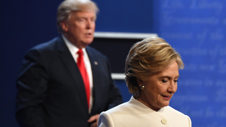 Hillary Clinton and Donald Trump walk off stage Wednesday after the third and final presidential debate at the University of Las Vegas in Las Vegas, Nev.