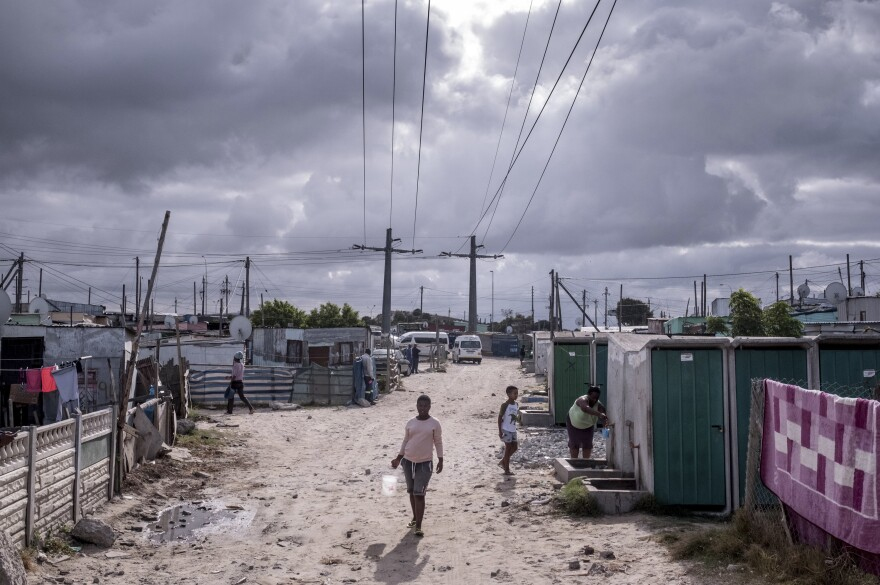 Residents of the township of Khayelitsha visit a communal water tap on day nine of South Africa's coronavirus lockdown.
