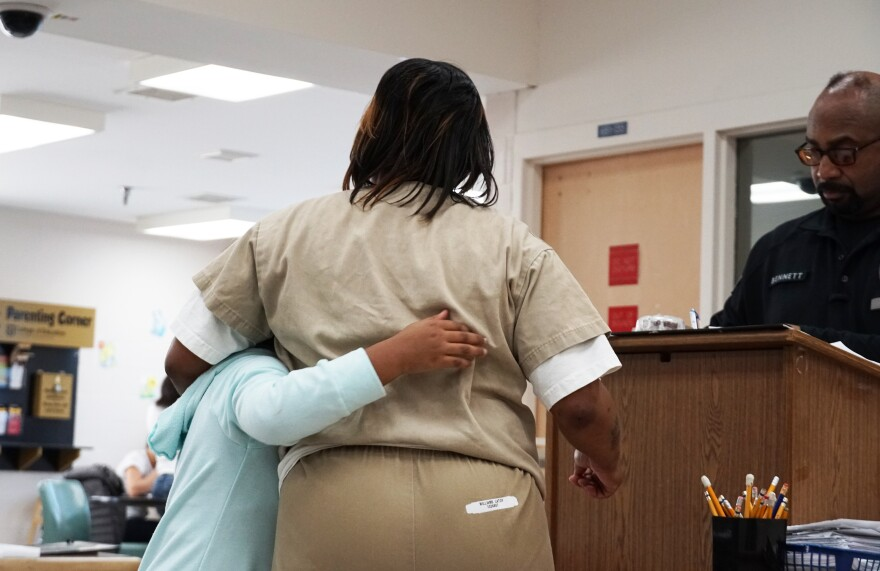 Latoy Williams greets her 7-year-old granddaughter, Dariana Williams, in the visiting room of Eastern Reception, Diagnostic and Correctional Center on February 23, 2020.
