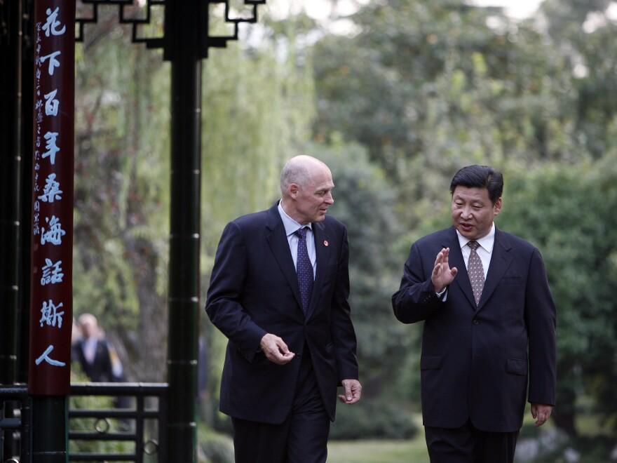 A 2006 photo of former U.S. Treasury Secretary Henry Paulson meeting with Xi Jinping in Hangzhou, China. Jinping became president of China in 2013.