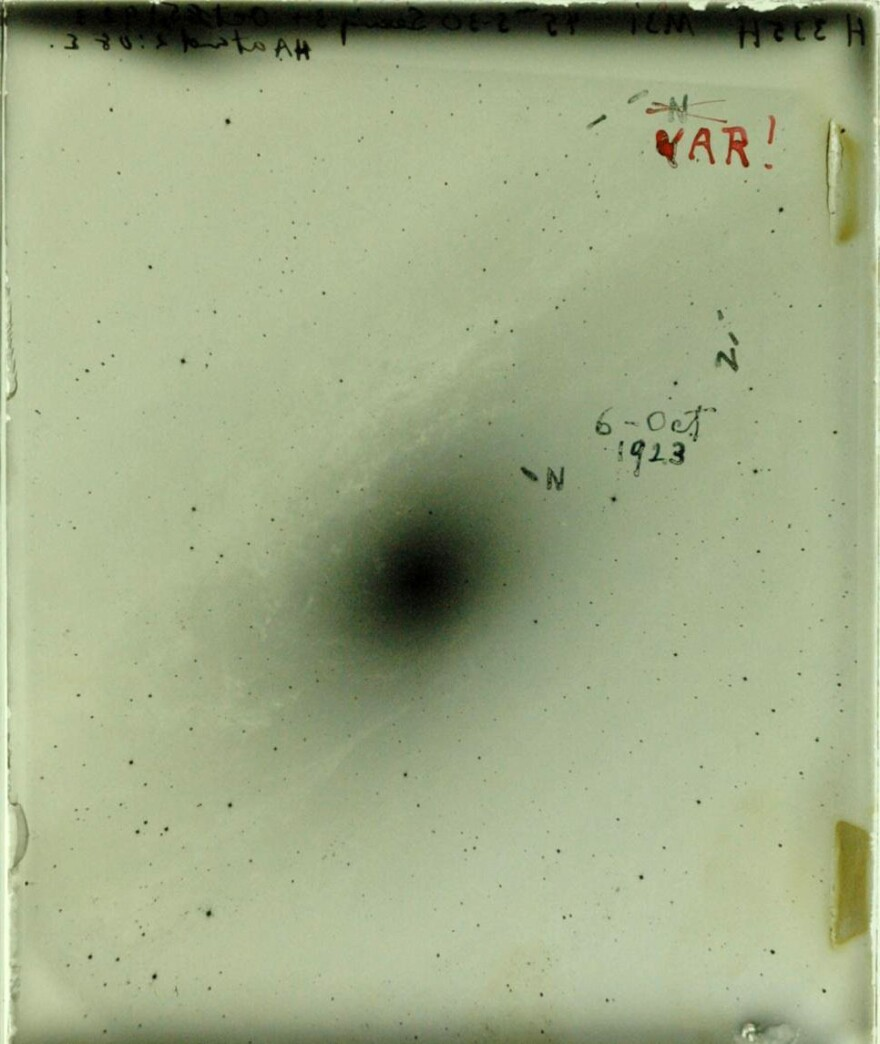This glass side of a photographic plate shows where Hubble marked novas. The red VAR! in the upper right corner marks his discovery of the first Cepheid variable star — a star that told him the Andromeda galaxy isn't part of our Milky Way.