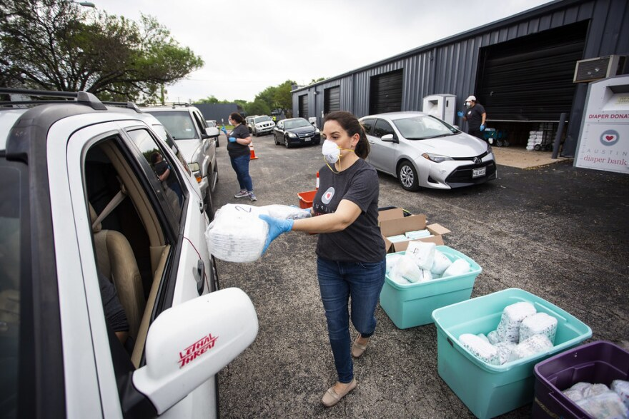 Holly McDaniel with Austin Diaper Bank distributes free diapers to families March 27.