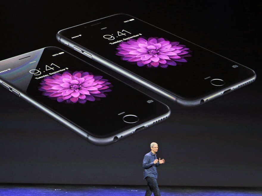 Apple CEO Tim Cook discusses the iPhone 6 and iPhone 6 Plus. Apple's market capitalization neared $700 billion late last month.