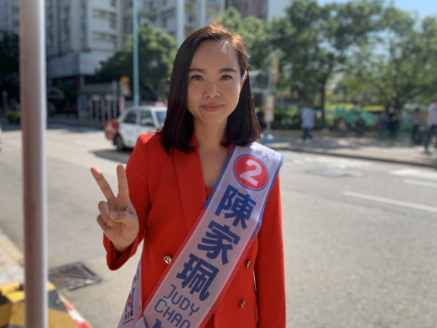 Judy Chan, the pro-Beijing incumbent from the New People's Party, is running against Kelvin Lam. She promises to restore order to a city she says has been shaken by protests.