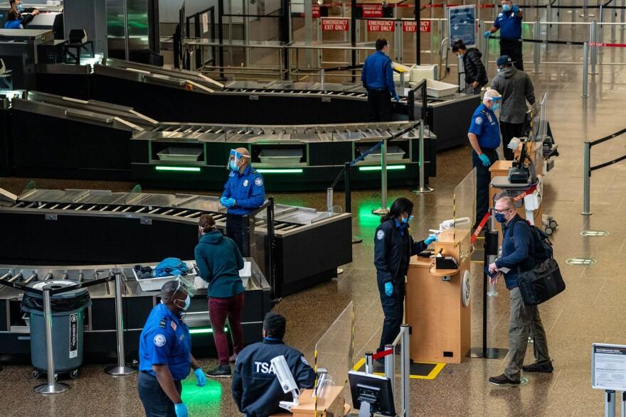 Travelers pass through security screening at Seattle-Tacoma International Airport on Nov. 29, 2020 in SeaTac, Washington state.