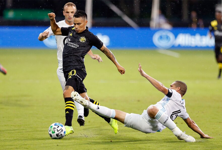 Minnesota United midfielder Osvaldo Alonso (6) tries to take the ball from Columbus Crew midfielder Lucas Zelarrayan (10) during the first half of an MLS soccer match in Kissimmee, Fla., Tuesday, July 28, 2020.