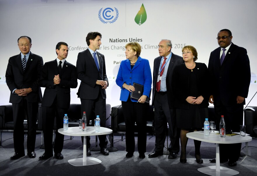 World Bank Group President Jim Yong Kim (from left), Mexican President Enrique Pena Nieto, Canadian Prime Minister Justin Trudeau, German Chancellor Angela Merkel, OECD president Angel Gurria, Chilean President Michelle Bachelet and Ethiopian Prime Minister Hailemariam Desalegn attend the Heads of State media event on carbon pricing, as part of the United Nations COP21 on Monday.