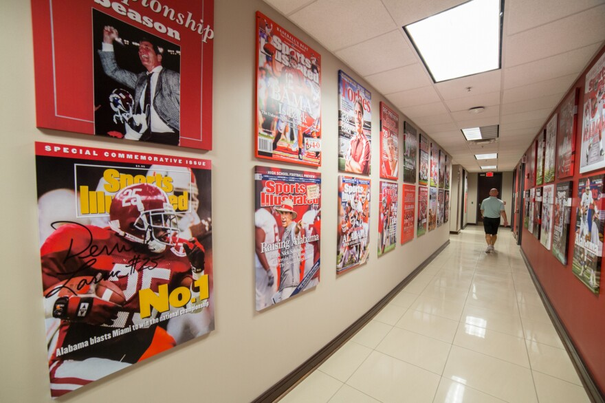 Throughout the Alabama Football administrative building, there are reminders of the Crimson Tide's dominance. Magazine covers highlight the team's success.