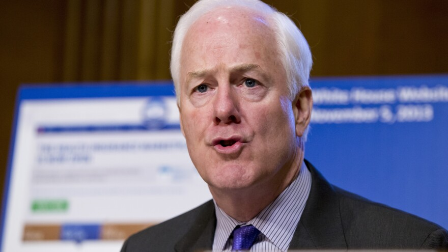 Sen. John Cornyn, R-Texas, the Senate minority whip, questions Health and Human Services Secretary Kathleen Sebelius before the Senate Finance Committee on Nov. 6.