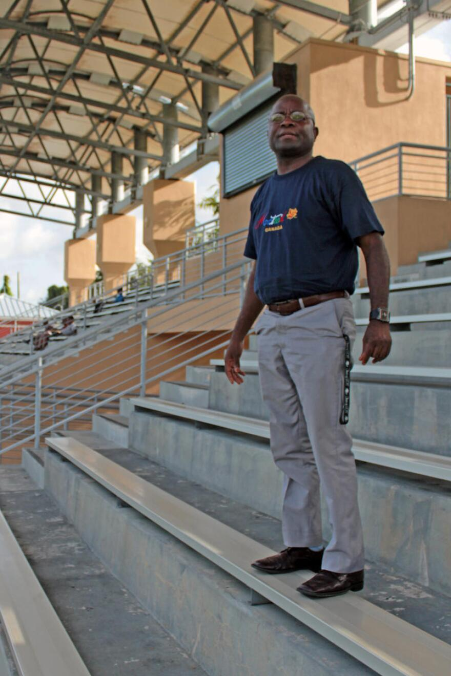 Gomez Lauleau stands on the bleachers watching his players practice at Little Haiti Soccer Park on July 27, 2016.