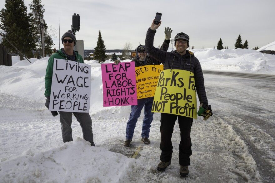 Picketers wave from the corner of Canyon St and Yellowstone Ave in West Yellowstone, Montana on Feb. 29, 2020.