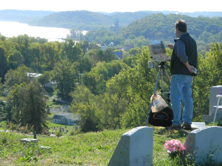 A painter works on a scene overlooking the Mississippi River in Louisiana, Mo., at the 2013 plein air event.