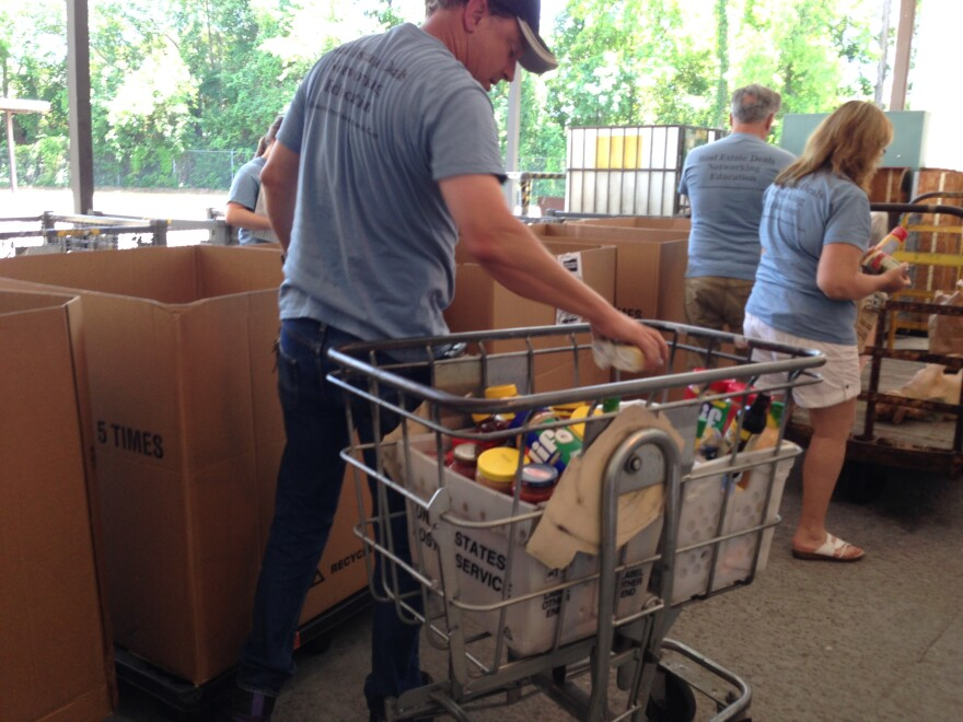 """The Tallahassee Investors Network volunteers at """"Stamp Out Hunger Day"""" at Second Harvest of the Big Bend"""