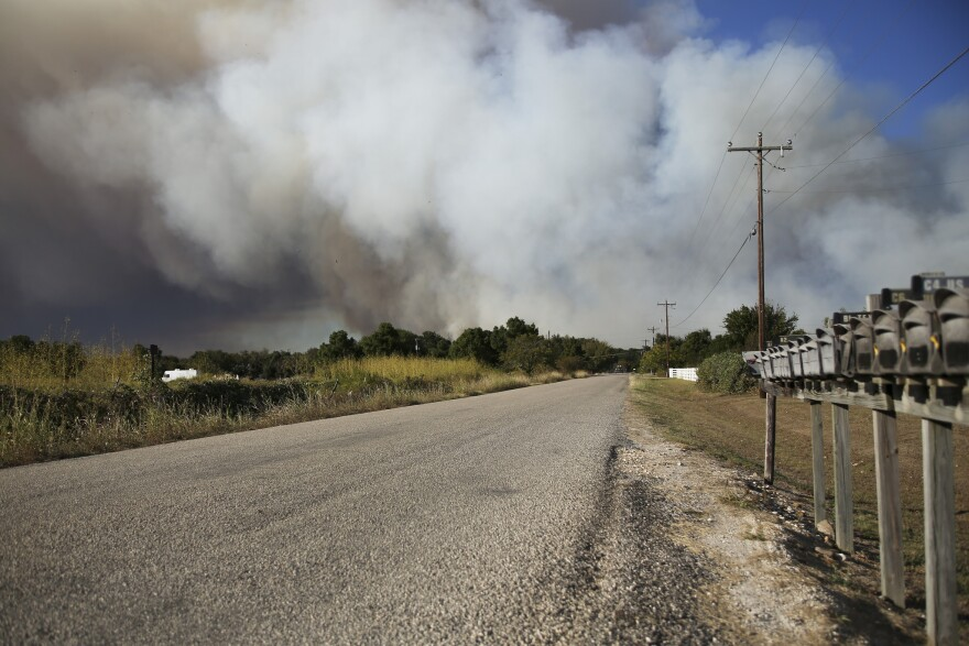 Smoke from the fire as seen from Kellar Road in Smithville on Wednesday afternoon.