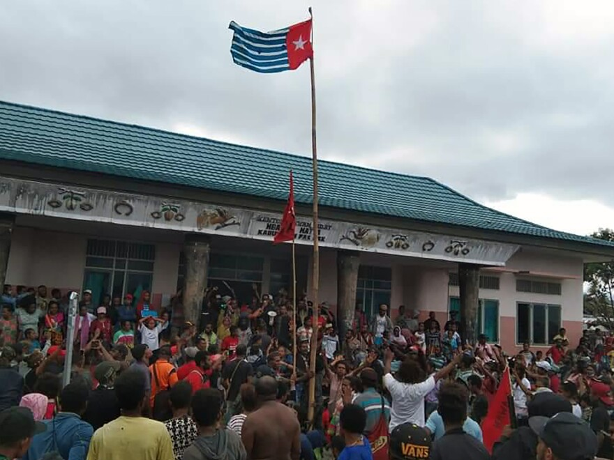 Protesters gather under the banned Papuan flag in the West Papua city of Fakfak on Aug. 21.