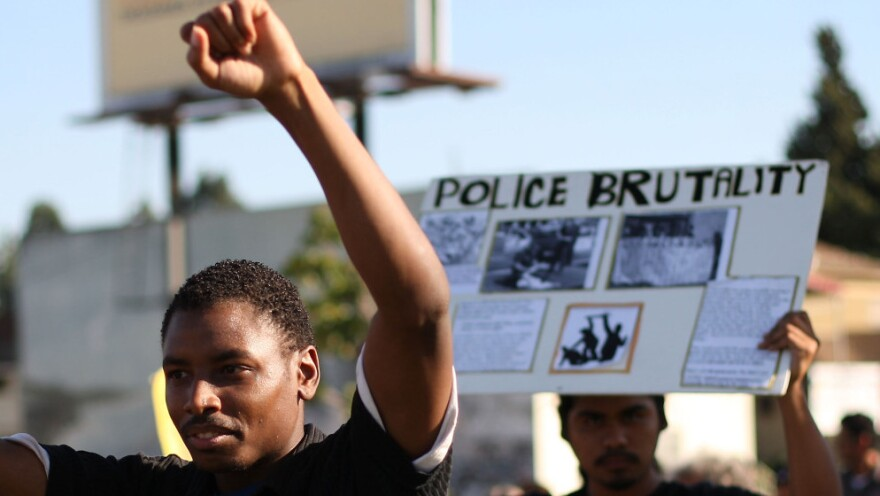 Demonstrators march in the National Day of Protest to Stop Police Brutality, in Los Angeles in 2009.