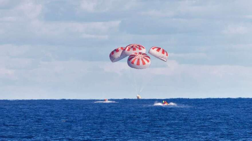 Capsule with parachutes lands in the ocean