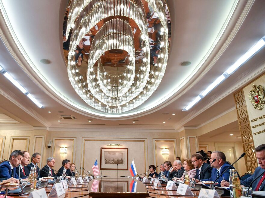 Members of a U.S. congressional delegation meet with members of the Russian Federation Council in Moscow on Tuesday. Republican senators met with Russia's Foreign Minister Sergei Lavrov on a rare visit to Moscow ahead of a summit between the countries' presidents Vladimir Putin and Donald Trump.