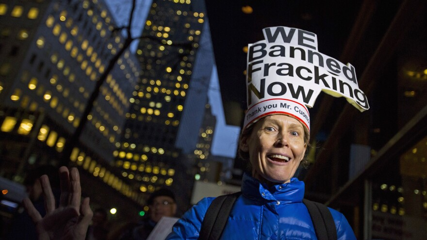 Leslie Roeder of New York City cheers outside New York Gov. Andrew Cuomo's office on Wednesday after the state announced a ban on hydraulic fracturing.