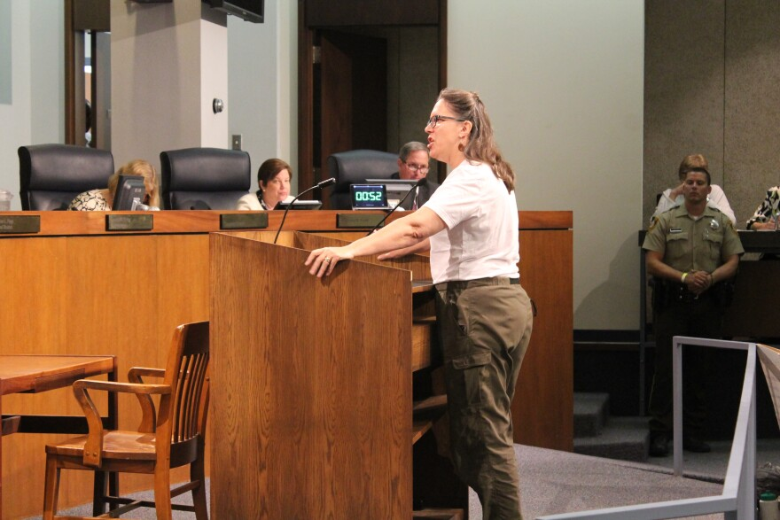 Ladue resident Susan Clark speaks during Tuesday night's St. Louis County Council meeting.