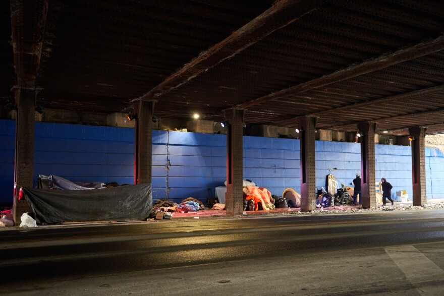 The mix of people in rows of tents under a bridge in Philadelphia's Kensington neighborhood includes homeless adults and some visitors from the suburbs who come here to inject opioids in secret.
