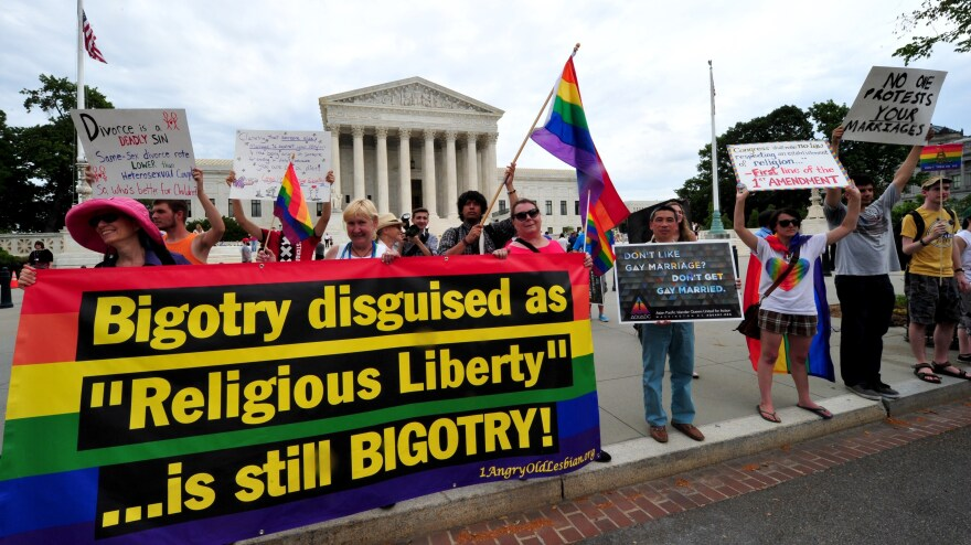 The Obama administration is set to announce expanded federal benefits for same-sex spouses, no matter what state they live in. On Thursday, demonstrators supporting same-sex marriage marched in front of the Supreme Court.
