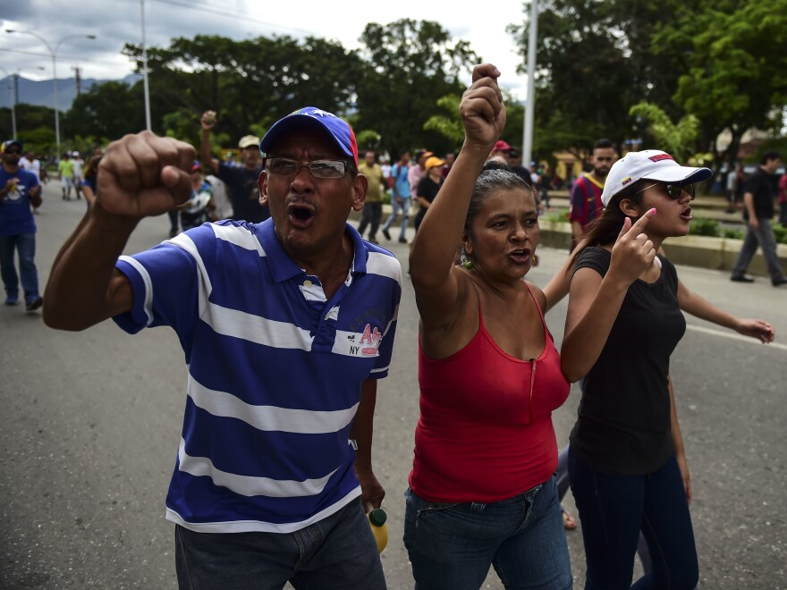 Anti-government activists protest in Valencia, one of Venezuela's largest cities, on Sunday.