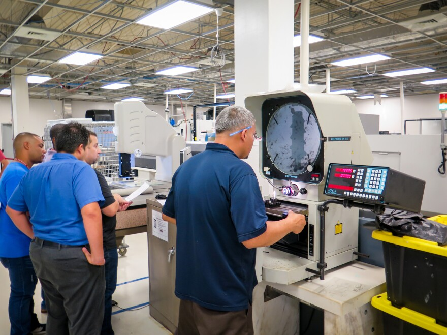 C-Axis employees came back to work days after Hurricane Maria. The plant has been operating via emergency generators, with no air conditioning available on the factory floor.