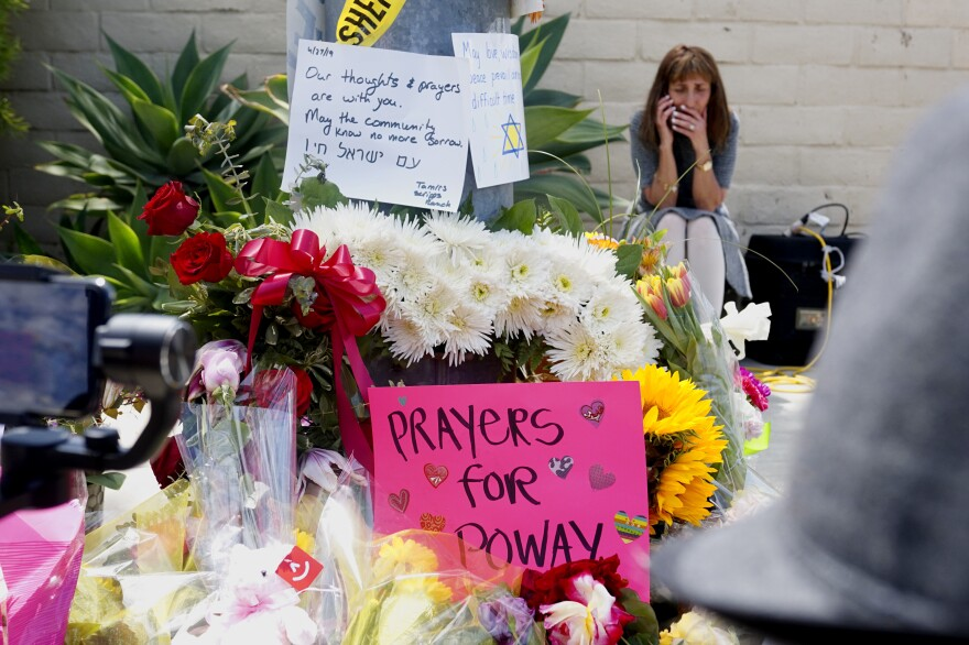 A memorial sits across the street from the Chabad of Poway Synagogue. On Saturday, one person was killed and three others injured when a gunman entered the building and fired his weapon.