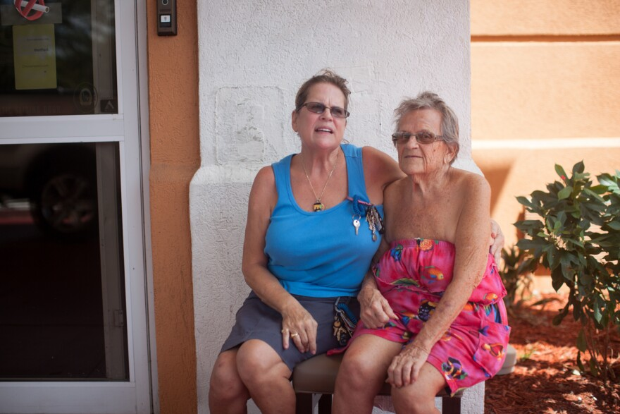 Connie Allen (left) and her mother, Nina Allen, at the Comfort Inn on Monday. They live nearby but wanted a safer place to stay during the storm.