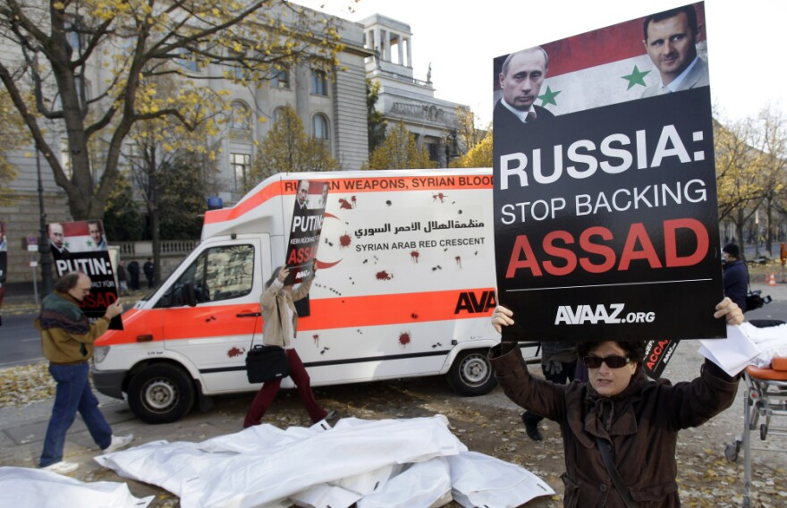 Campaigners from the international advocacy group Avaaz protest Russian arms sales to the Syrian government during a demonstration in front of the Russian Embassy in Berlin on Nov. 2.