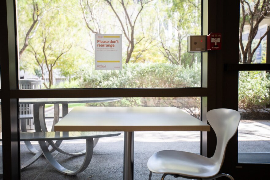A sign in the lobby of UT Austin's Belo Center for New Media tells students and others not to rearrange chairs.